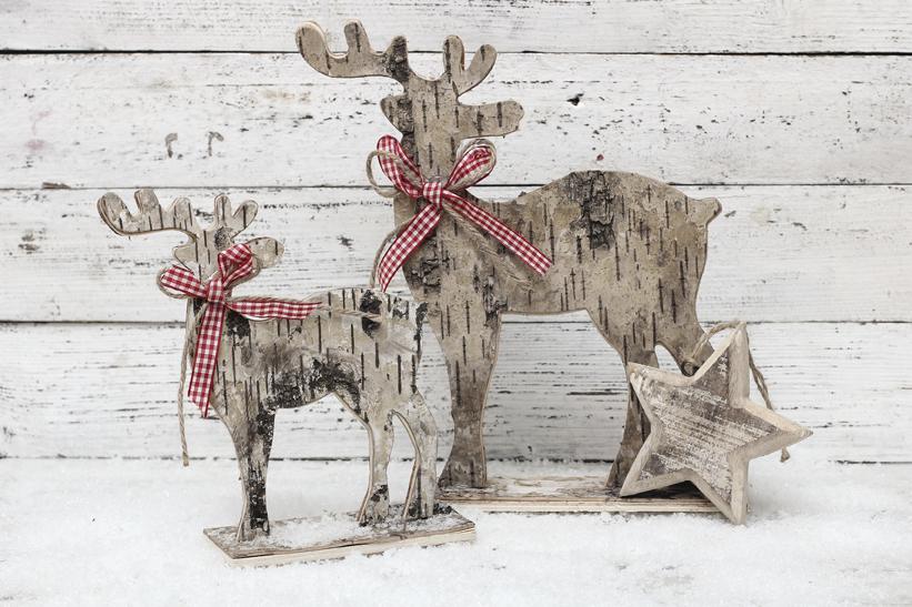Christmas Reindeer on wooden background in scandinavian style